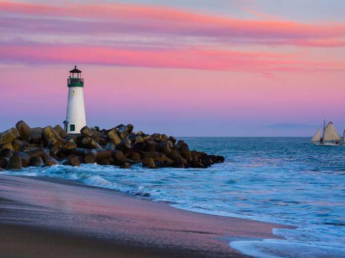 Santa Cruz Breakwater Lighthouse in Santa Cruz, California at sunset.