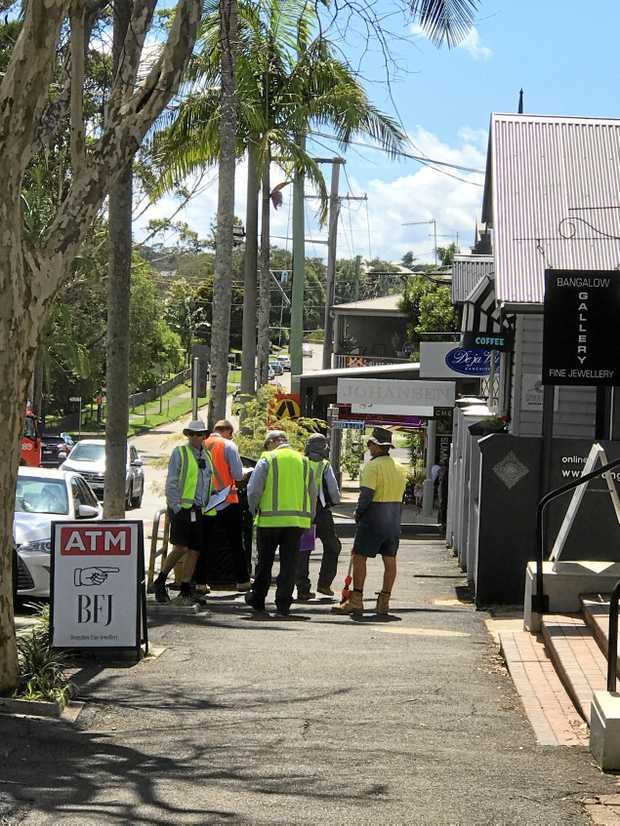 DONE DEAL: Workers preparing to install the paid parking meters in Bangalow.