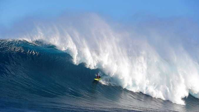 PERFECT WAVE: Gold Coast's Ryan Hipwood posts a perfect 10-point ride to win his semi at the WSL Big Wave Challenge at Pe'ahi, Maui.