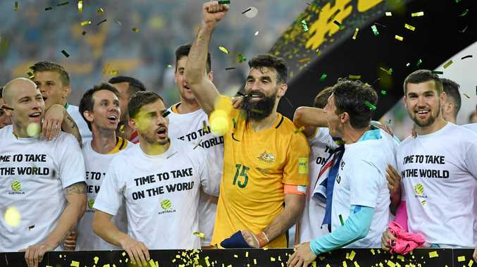 The Australia players celebrate winning the 2018 FIFA World Cup Intercontinental playoff.