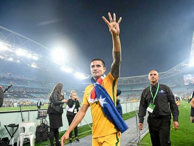 Tim Cahill holds up four fingers to symbolise his fourth World Cup finals.