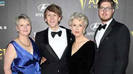 Josh Thomas with his real mum (left), his TV mum, Debra Lawrance and best friend, Tom Ward.