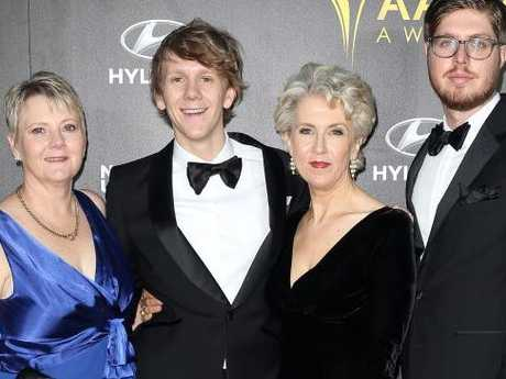 Josh Thomas with his real mum (left), his TV mum, Debra Lawrance and best friend, Tom Ward.