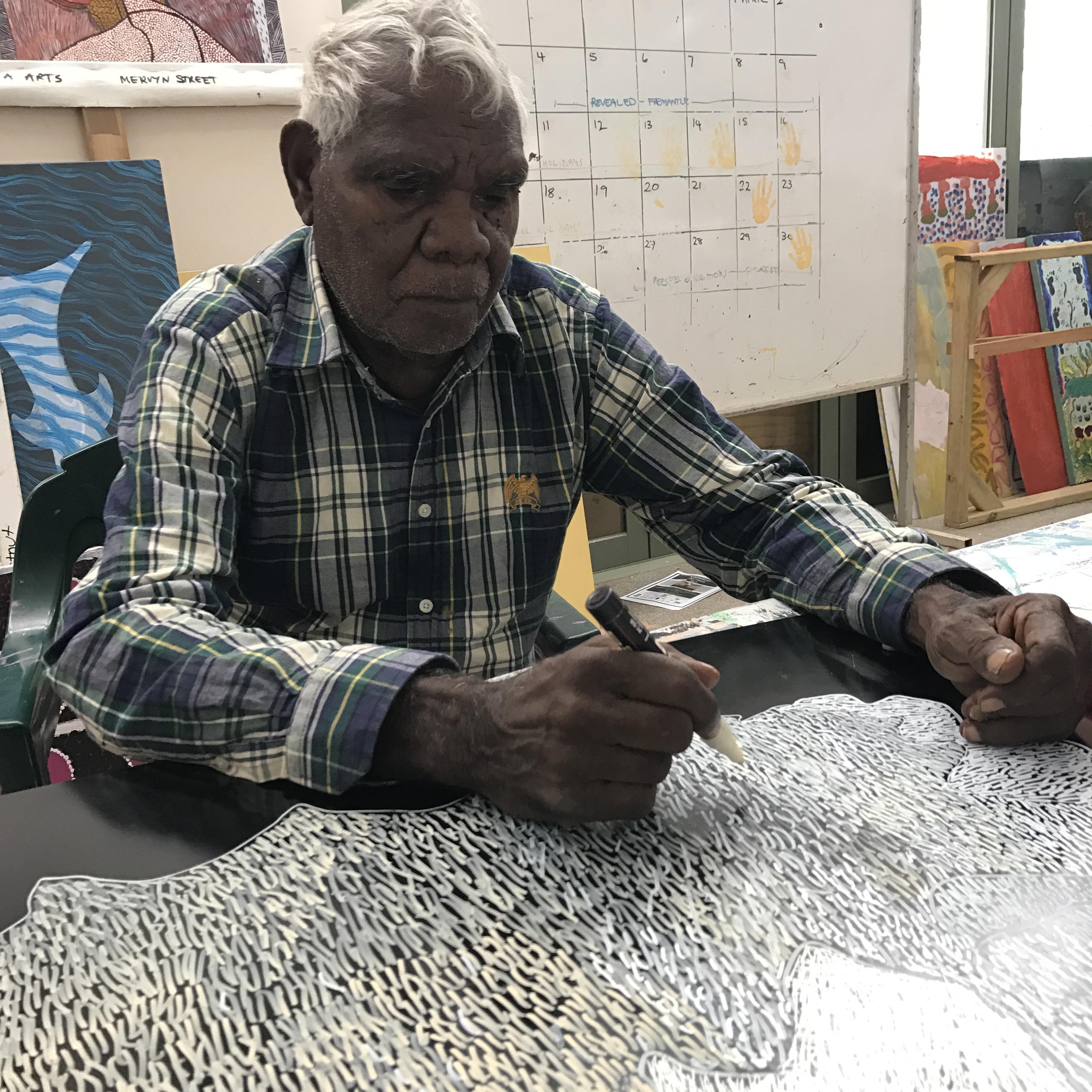 ELDER ARTISTS: Ngarralja Tommy May at work at project partner Mangkaja Arts Resource Agency.