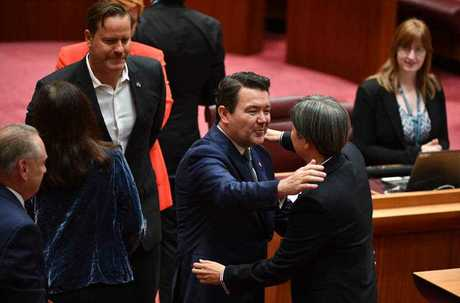Liberal Senator Dean Smith hugs Shadow Minister for Foreign Affairs Penny Wong after speaking on the Same Sex Marriage Bill debate in the Senate chamber at Parliament House in Canberra, Thursday, November 16, 2017. (AAP Image/Mick Tsikas)