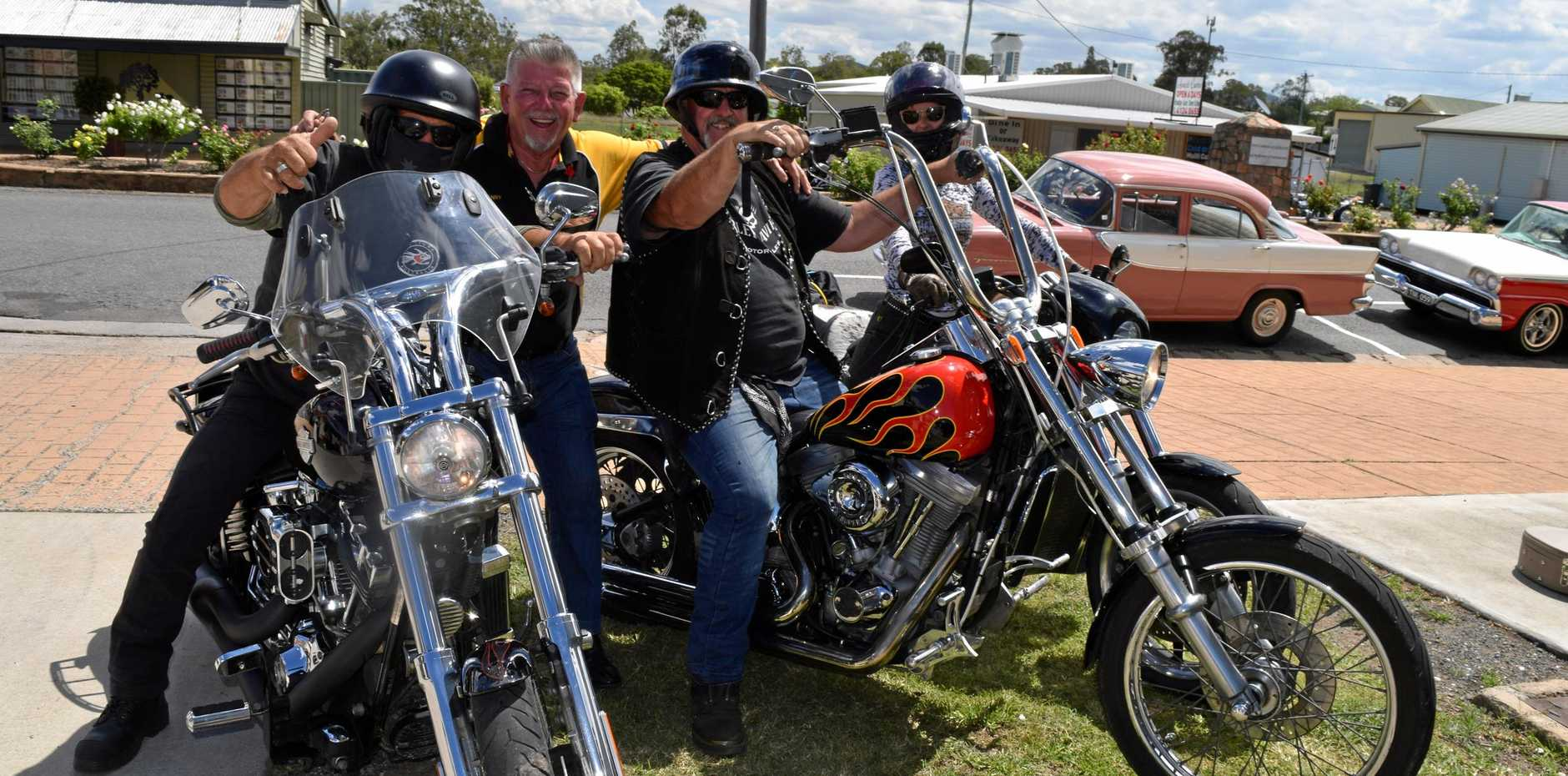 GREAT DAY OUT: Danny Nevins of the Grand Hotel at Biggenden welcomes some of his biker mates to town for the inaugural hot rod and custom car show.