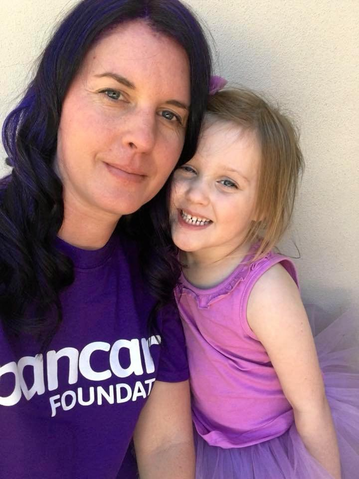 Phoebe Waldron dyes her hair purple in support of Pancreatic Cancer Awareness Day after losing her mum to the disease. She is pictured here with her daughter.