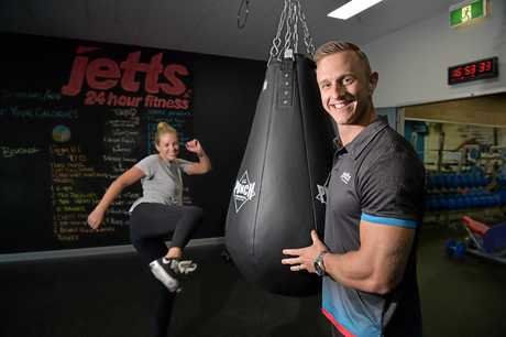Award-winning personal trainer Josh Every pictured with Monika Brayshaw working out at Jetts Maroochydore gym.