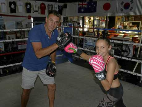 Ten-year-old Toowoomba boxer Lekaysha Woodbridge and trainer Brendon Smith at TGW & Smithy's Gym this week.