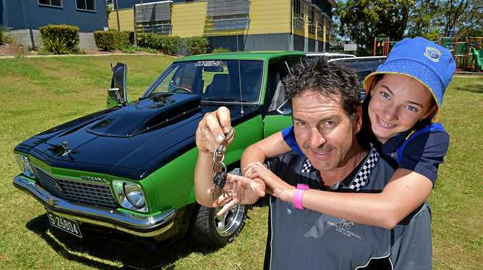 Craig O'Brien is aiming to sell his restored Torana to fund his children's future education. Craig is pictured with his daughter Madison.