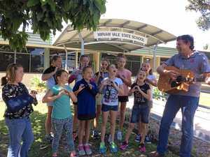 Bunker down: Kids prepare for disaster through song