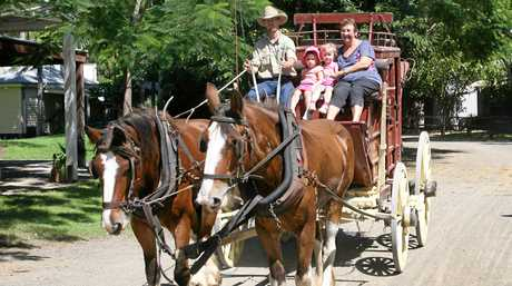 L-R Ellie and Matilda Haggarty and Libby Ahern take a ride on the stage coach at the Heritage Village. Funding is needed to upgrade the facility.
