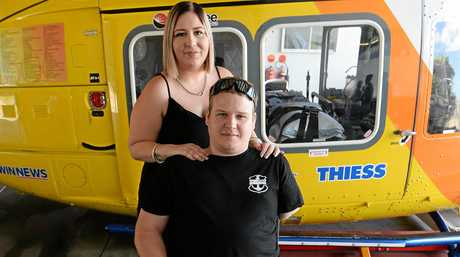 FIGHTING BACK: Teneile Davis and Dayne Ladbrook during a visit to the RACQ Helicopter Rescue Service hangar to thank them for saving his life.