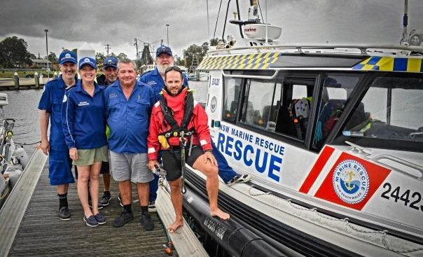 SAFE NOW: Grant Rawlinson (in red), who attempted to row from Coffs Harbour to New Zealand, was rescued by Ballina Marine Rescue.