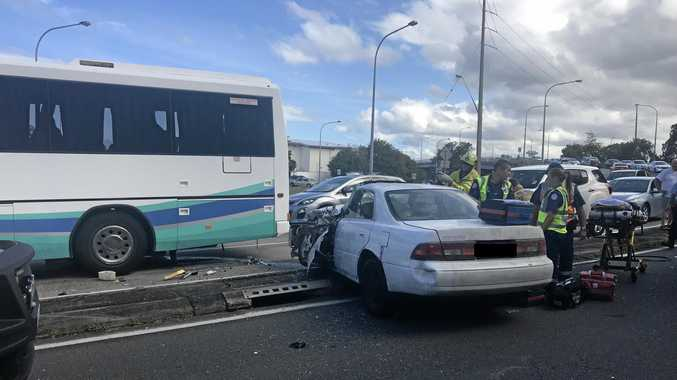 A school bus and car have collided in Tweed Heads.