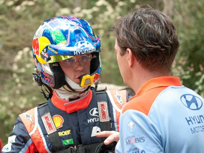 DEEP DISCUSSION: Thierry Neuville talks about the performance of his car with a Hyundai team member.