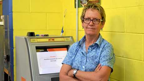 CASHLESS: Owner of the Springsure Convenience and Takeaway, Desley Abdy by her ATM, currently out of cash.