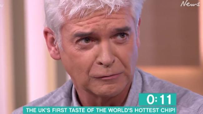 'Like a dragon's nostril': British TV host Phillip Schofield had a medical emergency after eating the world's 'hottest chip'.