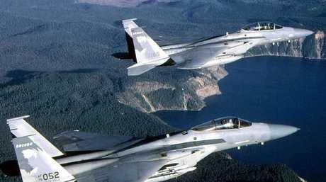 Two F-15 jet fighters in flight over Crater Lake, Oregon. Despite their speed and radar, they were reportedly unable to locate the mystery aircraft. Picture: USAFSource:News Corp Australia