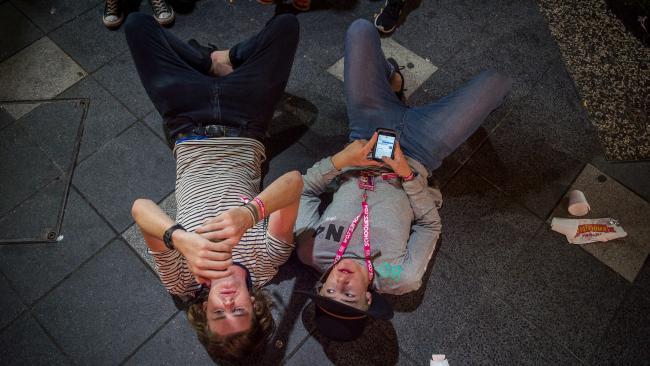 Two 2016 Schoolies attendees take a break. (Pic: Jake Nowakowski)
