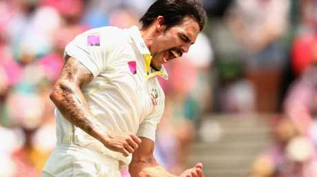 Mitchell Johnson celebrates taking the wicket of England captain Alastair Cook during the 2013/14 series.