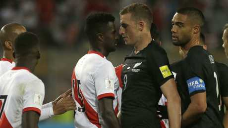 Peru's Christian Ramos, centre left, and New Zealand's Chris Wood confront each other during the match.