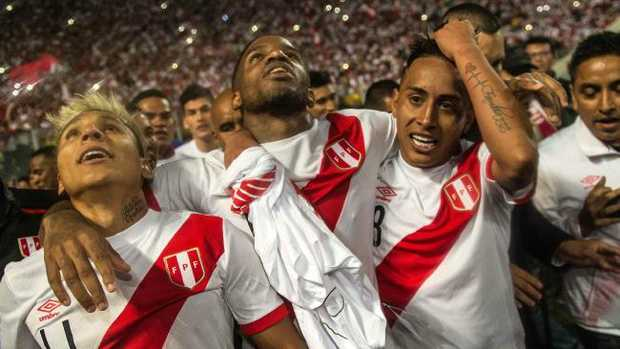 Peru's Raul Ruidiaz (l-r), Jefferson Farfan and Christian Cueva celebrate qualifying for the FIFA World Cup after their 2-0 win over New Zealand on Thursday.