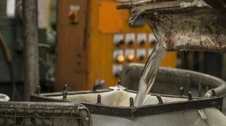 Molten aluminium is poured through a sieve at the Nissan Australia Casting Plant. Picture: Supplied