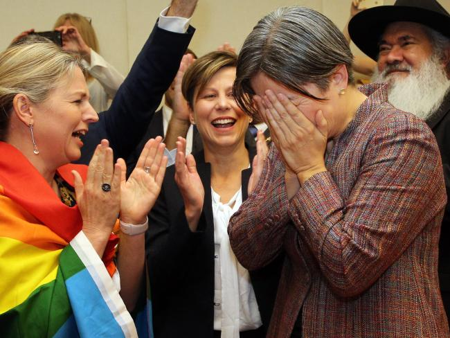 Senator Louise Pratt and Jenny McAllister with an emotional Penny Wong. Picture: Gary Ramage