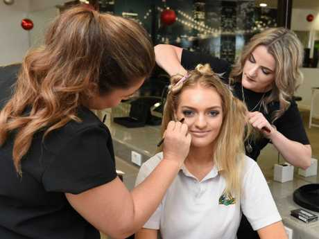 Josephine Desgrand from Hervey Bay High School gets ready for her school formal at Headlines Hair & Beauty with (L) Sarah Barber and Ashleigh Binstead.