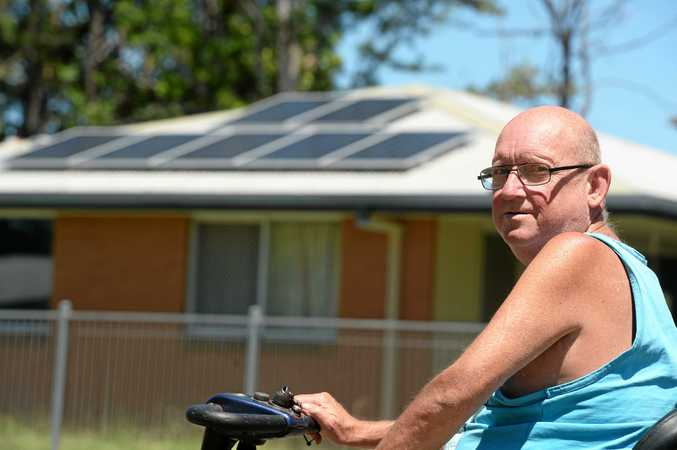 POWERED UP: Darrin Ferguson is angry about solar panels going in across the road on housing commission houses.