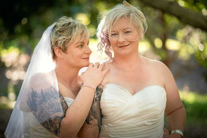 LOVE: Michelle Marriott and Claire Cooper on their wedding day.