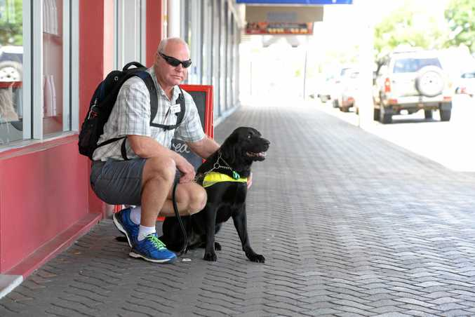 POLICE INVESTIGATING: Vision-impaired Bundaberg man Graeme Raines, with guide dog Levi, was assaulted on Woongarra St this morning.