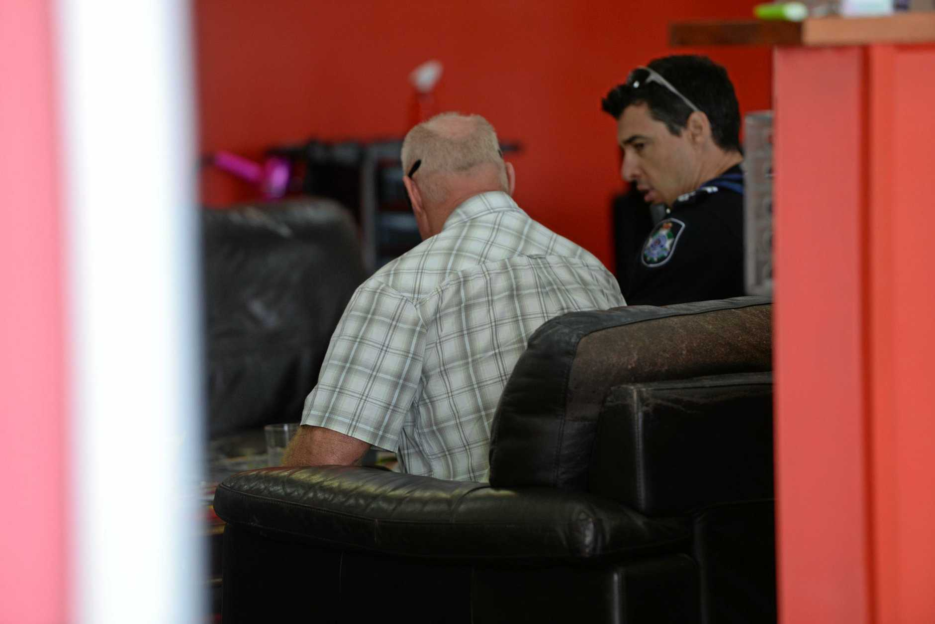 POLICE INVESTIGATING: Graeme Raines gives a statement to police inside Zest hair salon where he took refuge after being attacked on Woongarra St this morning.