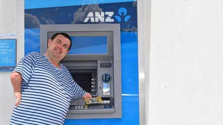 Springsure local Matthew Thomas is happy to finally be able to withdraw cash from the  ANZ ATM.