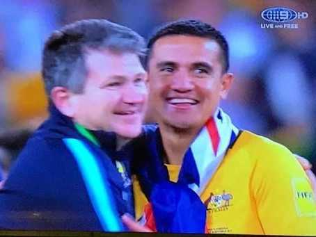 Coast physio Kurt Lisle and Socceroo Tim Cahill embrace after Australia's win over Honduras to qualify for the 2018 World Cup.