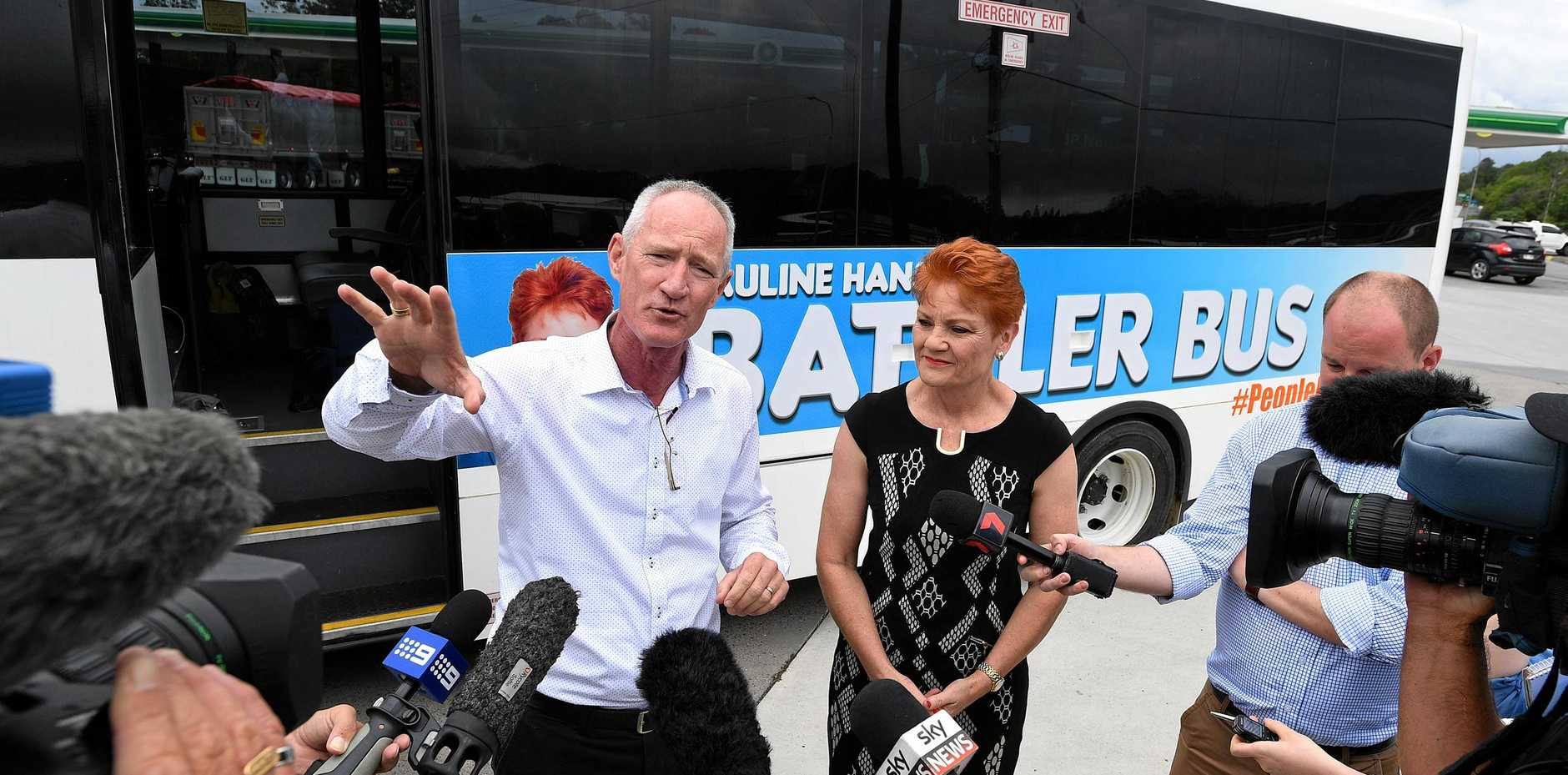 BATTLER BUS: Queensland One Nation leader Steve Dickson (left) and One Nation leader Pauline Hanson are seen during a doorstop at a Nambour petrol station after departing on tour from Brisbane, Monday, November 6.