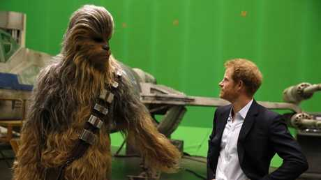 Prince Harry met Chewbacca during a tour of the Star Wars sets last year.