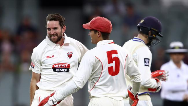 Chadd Sayers celebrates the wicket of NSW's Kurtis Patterson.