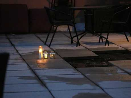 Candles mark the spot at 19 Clinton Street, in New York's Lower East Side, where Julian Simpson died. Picture: Stuart Ramson