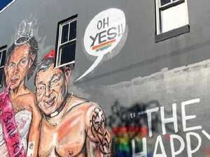 Controversial Abbott and Pell mural attacked by three men