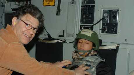Al Franken appearing to grope Leeann Tweeden while she's sleeping.