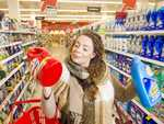 Shopper checking unit prices to save on grocery bills. Picture: Eugene Hyland