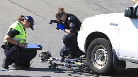 Queensland Police inspect the damage at a serious car crash at Coolangatta. Photo: Scott Powick.