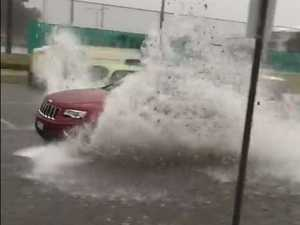 Coast downpour brings flash flooding