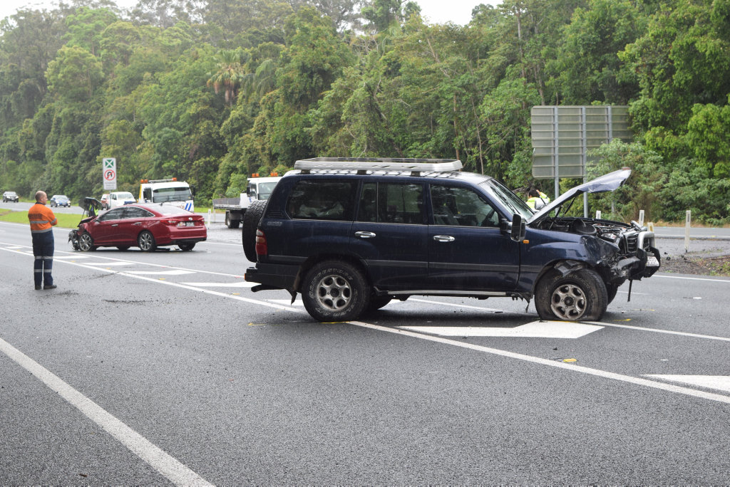 A four-wheel-drive rests in the northbound lanes of the Bruce Hwy at Forest Glen after being involved in a three-vehicle crash.