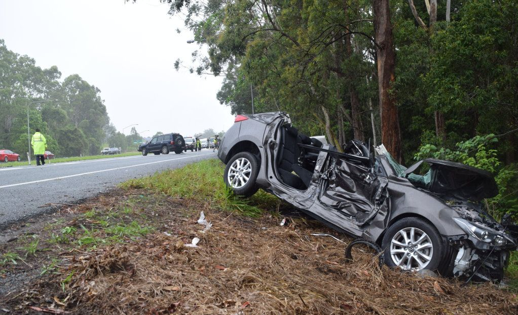 Firefighters had to cut two people free from a sedan that was involved in a three-vehicle crash on the Bruce Hwy at Forest Glen.