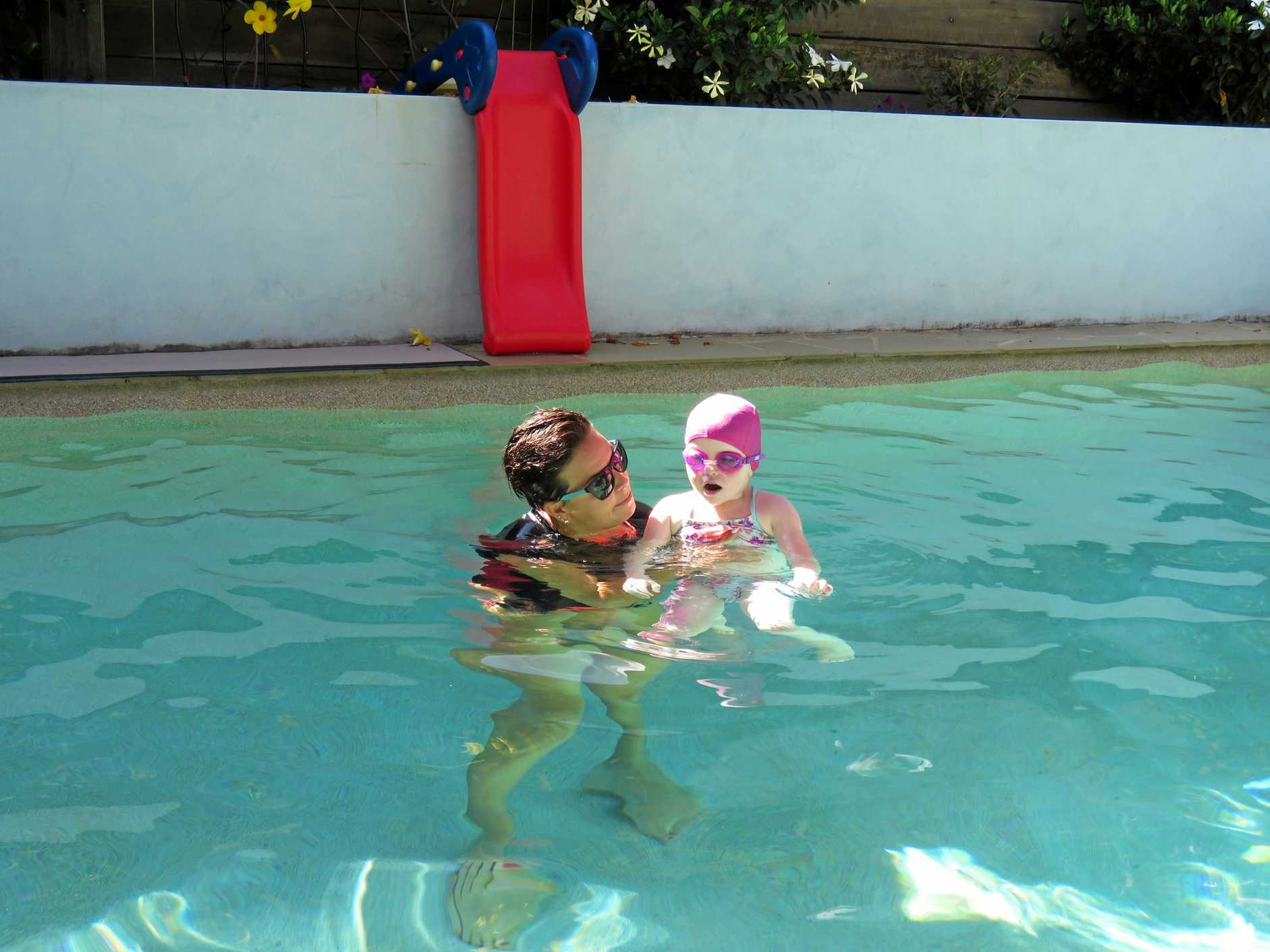 Alana Harber takes her three swim students through their paces at her home-based pool