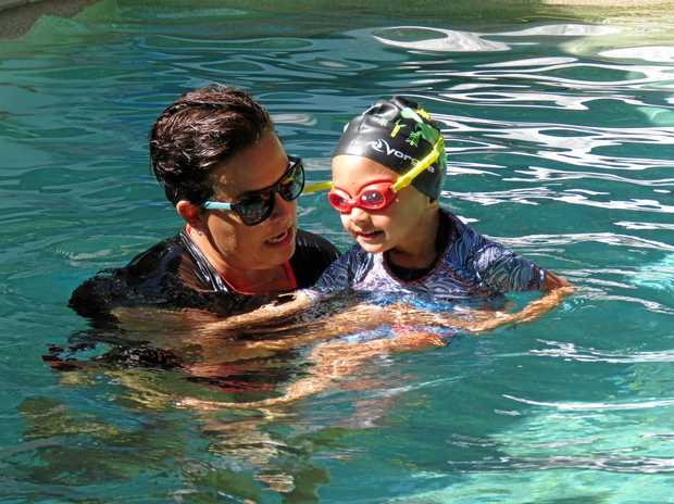 Alana Harber takes one her young swim students through their paces at her home-based pool.