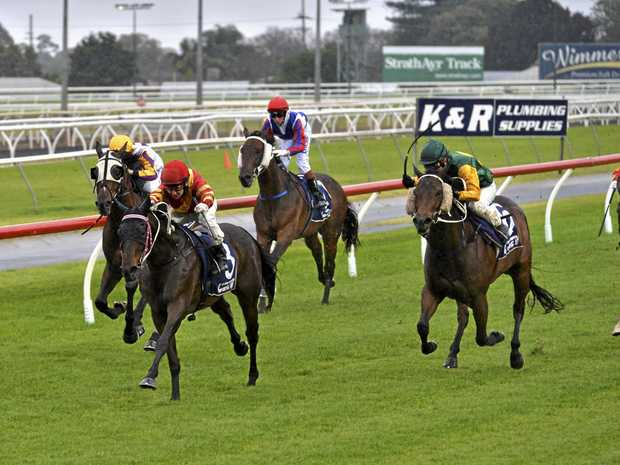 Rhiatenn Road and jockey Nozi Tomizawa head for victory in today's Benchmark 65 Handicap at Clifford Park.